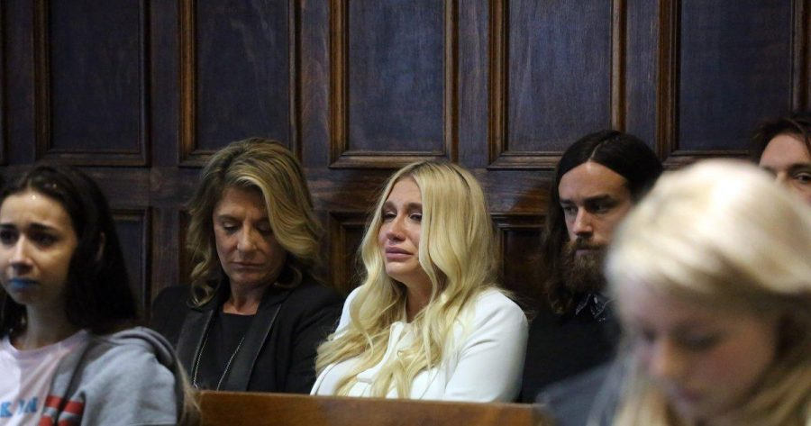 Kesha receives the news of her contract being upheld tearfully. This image quickly became iconic, representative of a watershed moment in the music industry where sexism came to light in a serious way.
