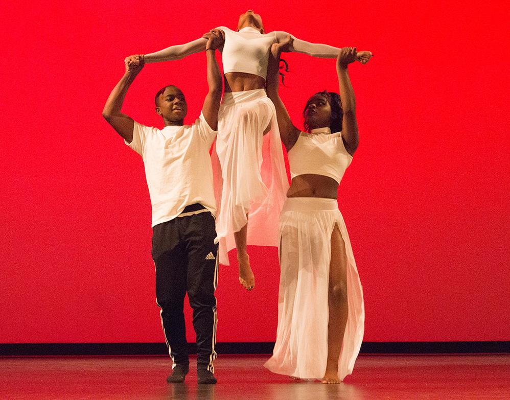 "(Photo Courtesy of Manan Dhir) Jailen Gardener and Jasmine Ofodu lift Bailiie Robinson to the song ""Freedom"" by Beyonce."