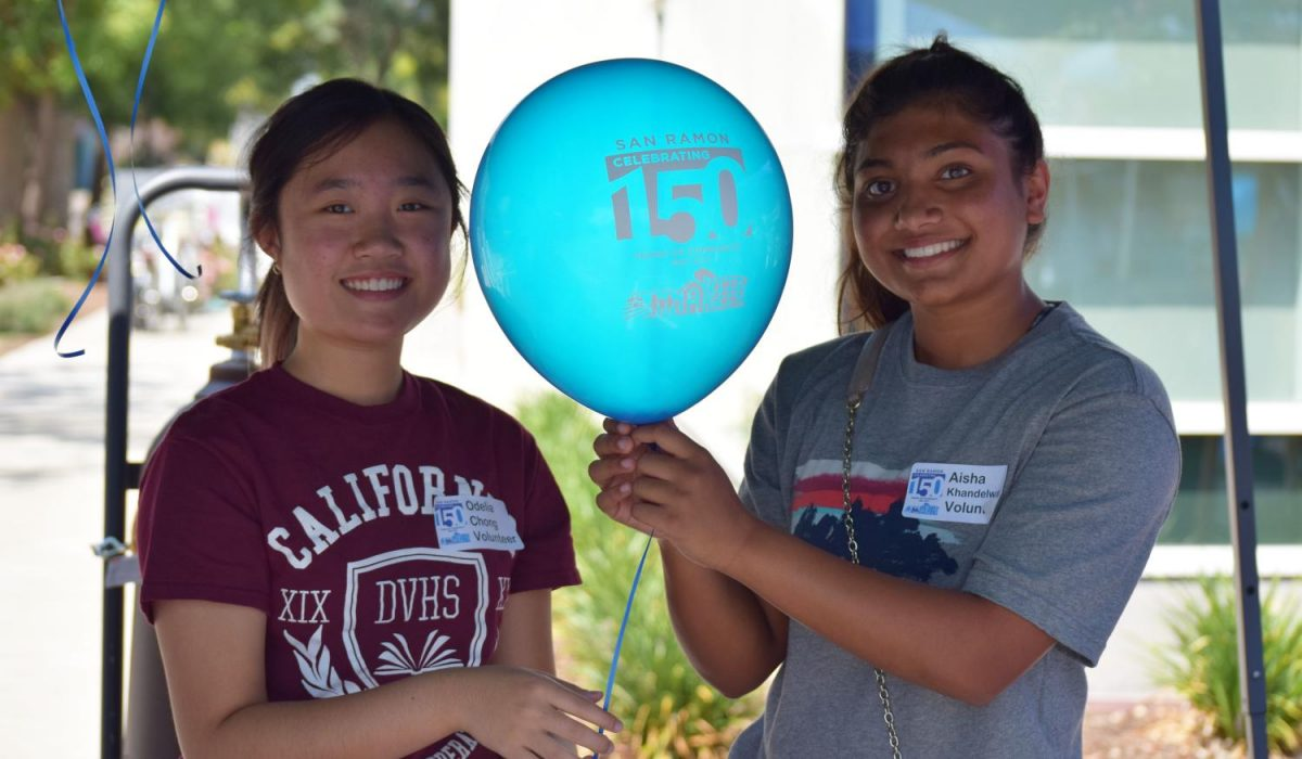Two CSF volunteers, Odelia Chong, left. and Aisha Khandelwa, right, pose for a photo outside of City Hall in celebration of San Ramon's 150th Anniversary