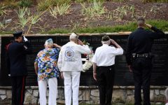 A San Ramon Valley Fire Department Guard of Honor, two Pearl Harbor survivors and a San Ramon Valley police officer (from left to right) salute the All Wars Memorial at the All Wars Memorial Park during the raising of the flag. The flag-raising was the last event of San Ramon Valley's 12th 9-11 Remembrance Ceremony.