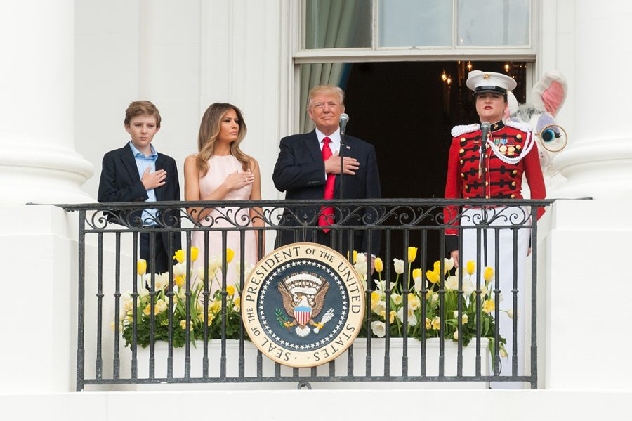 "President Donald Trump, First Lady Melania Trump, and their son, Barron Trump, have their hand over their heart while ""The President's Own"" U.S. Marine Band performs the National Anthem, Monday, April 17, 2017, kicking off the 139th Easter Egg Roll at the White House.  (Official White House Photo by Joyce N. Boghosian)"