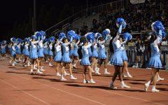 Varsity and JV Cheer harmonize
