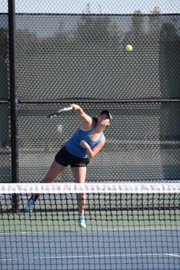 Senior Christina Wang volleys against Sydney Pournaras