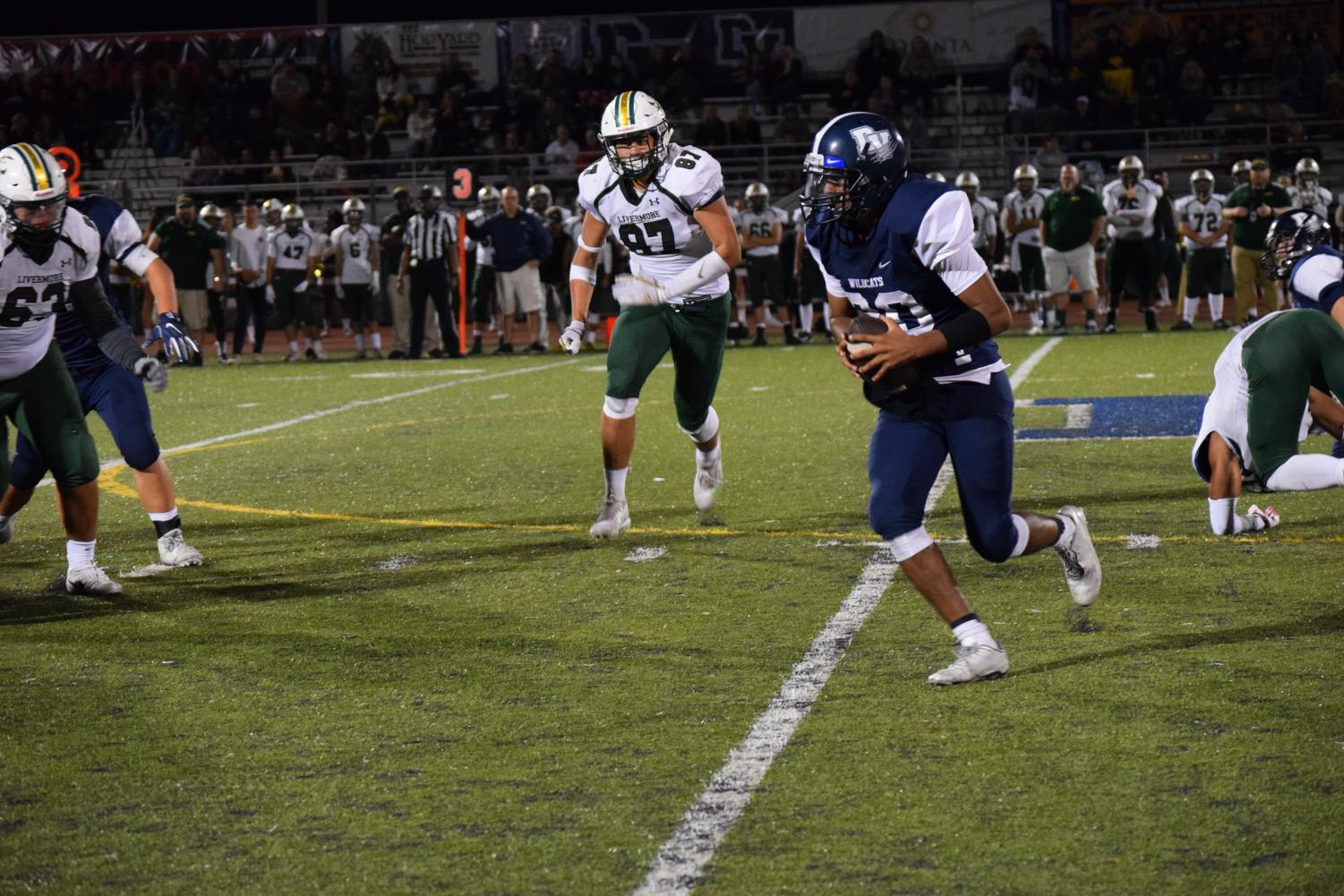 Junior Steven Bratcher rushes for the first down