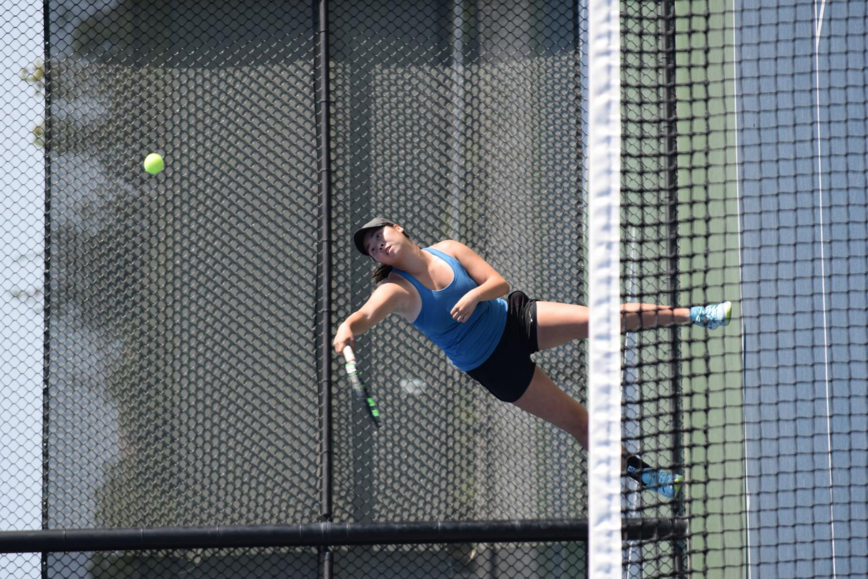 Senior Christina Wang volleys against Sydney Pournaras. // SKYLER SPEARS