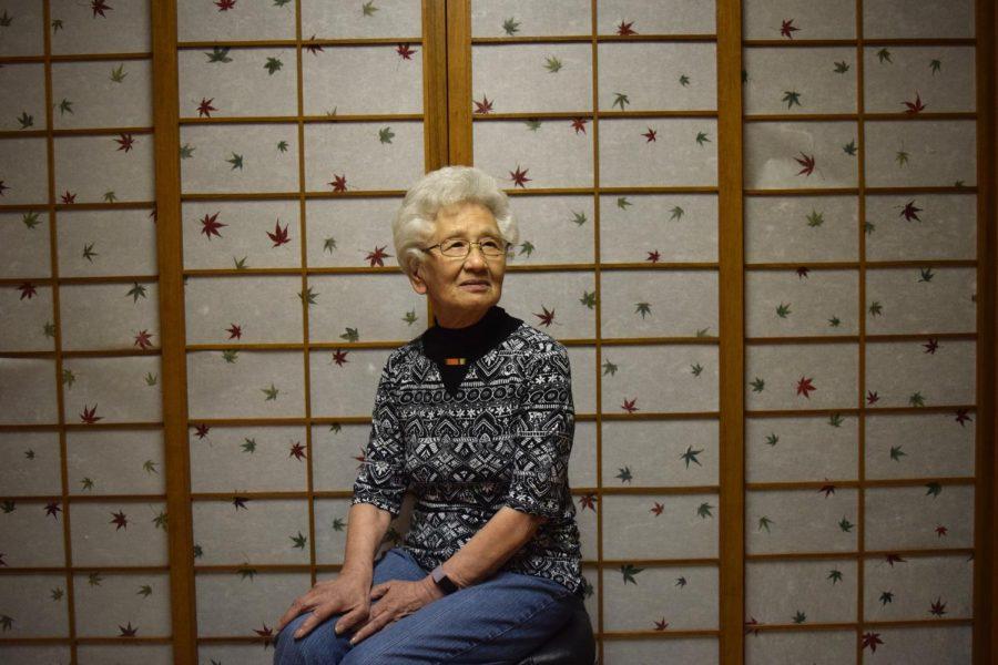 Takeko sits in front of the shoji doors her husband built.