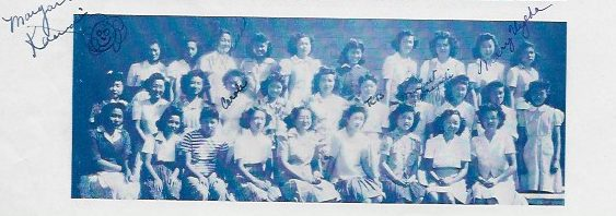 Takeko is seated third from the left on the second row of this yearbook photo.