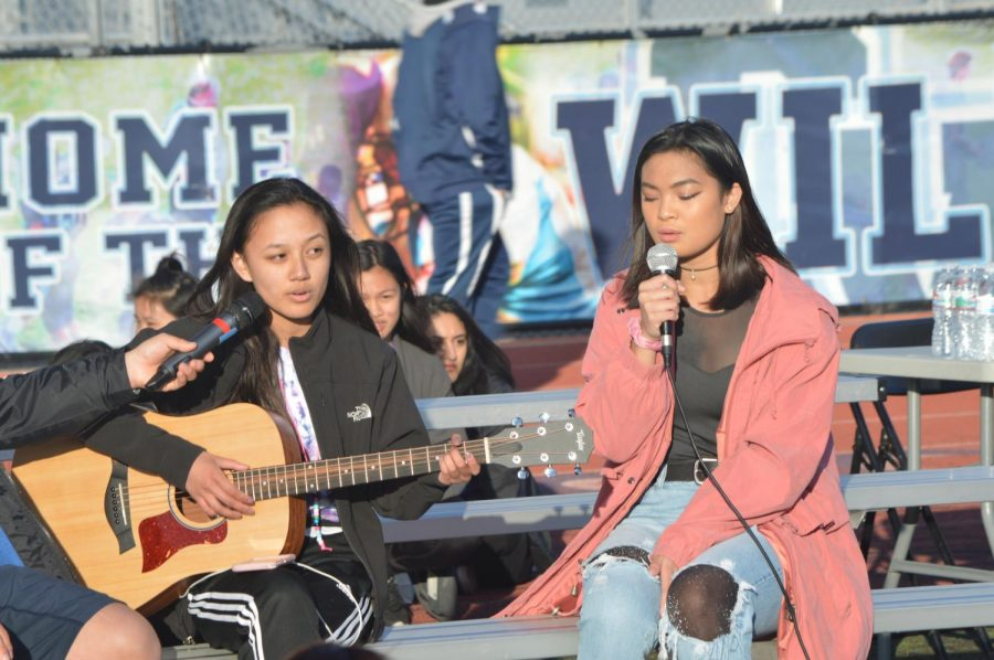 """In their Sunset Serenade performance of """"Carry Me Home"""" by Jorja Smith, sophomores Alyssa Kathryn and Bea Ocampo combine determined voices on the song's last chorus. """"It was a nice, mellow song that had a good message about how there's always going to be someone you can depend on when you're down,"""" Alyssa said."""
