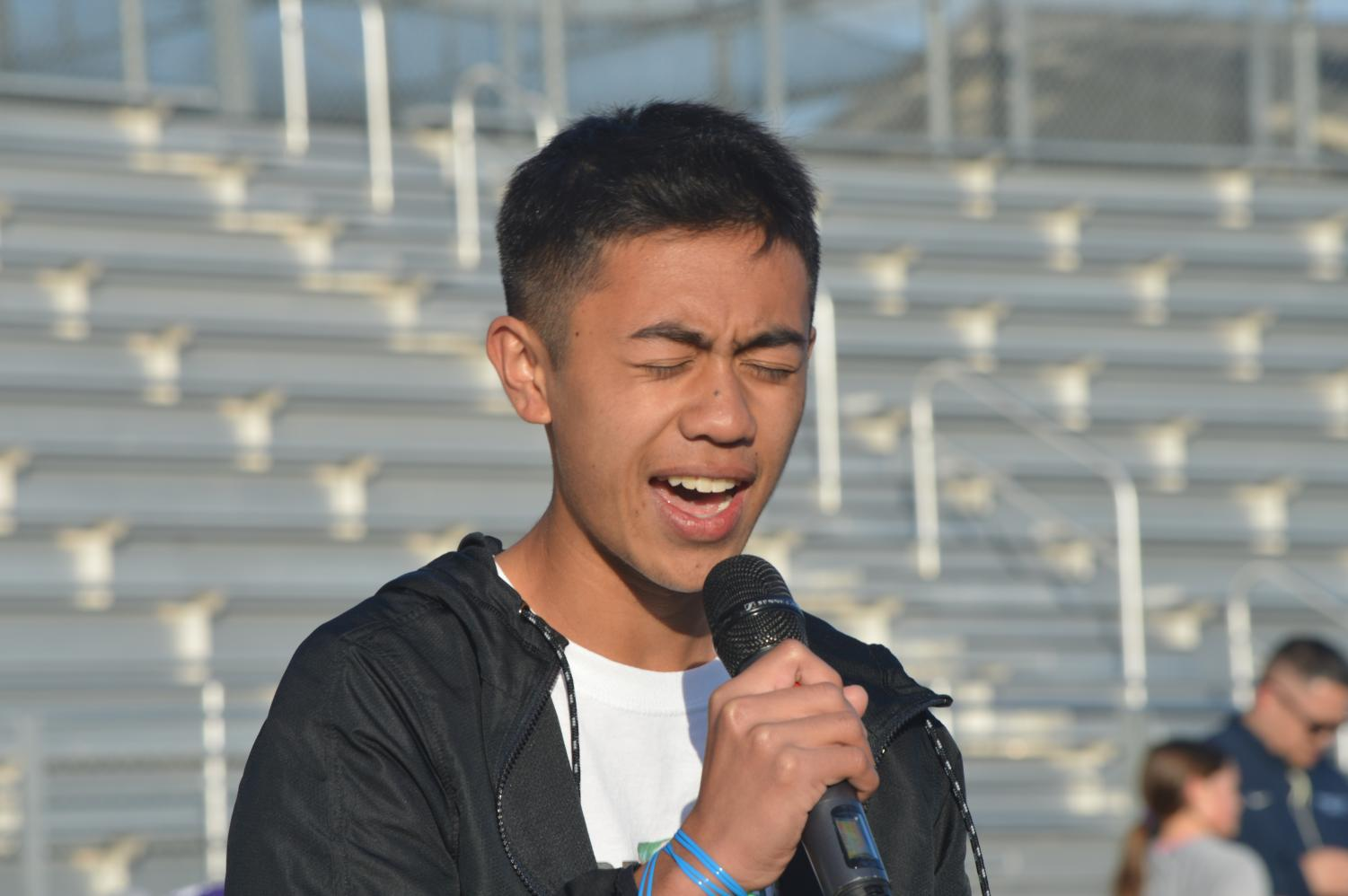 "Junior Matt Braga delivers a spine-chilling rendition of Jason Mraz's ""I Won't Give Up,"" bringing his voice to power as he stood up defiantly at the second chorus. ""'I Won't Give Up' gives the idea that for every tragedy or heartbreak there is always hope waiting around the corner … for all of us who feel broken on the inside,"" Matt said."