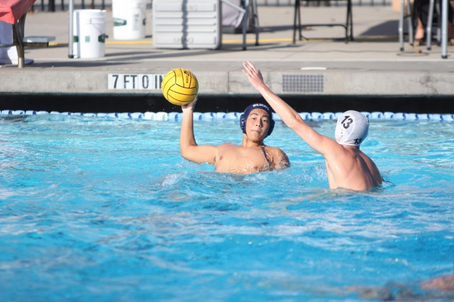 Junior Kyle Takeuchi scans the pool for a teammate to make a pass to.