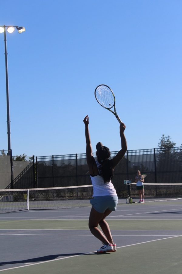 Junior Jahnavi Reddy serves to a Livermore player on Sept. 11.