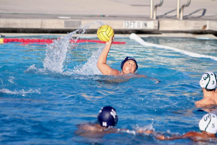 Senior David Wong carries the ball towards the goal, ready to score.