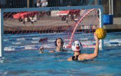 Sophomore Abby Bradford prepares to block a penalty shot.