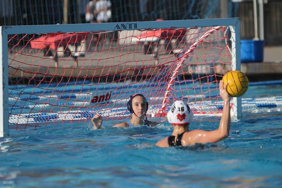 Sophomore Abby Bradford prepares to block a penalty shot.