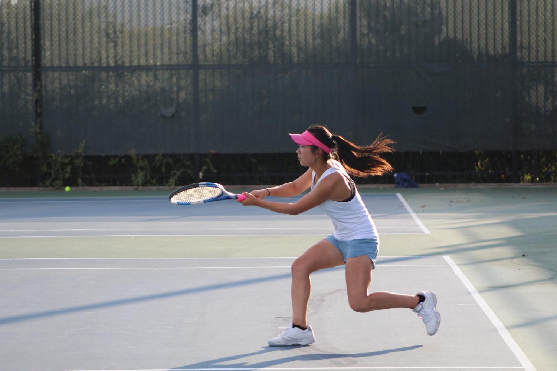 Junior Jasmine Lam prepares to strike the tennis ball.