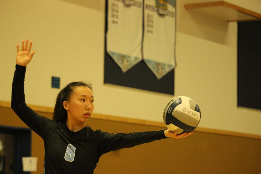 Dougherty+Valley+junior+Elizabeth+Lee+prepares+to+serve+the+ball+toward+the+California+High+side.