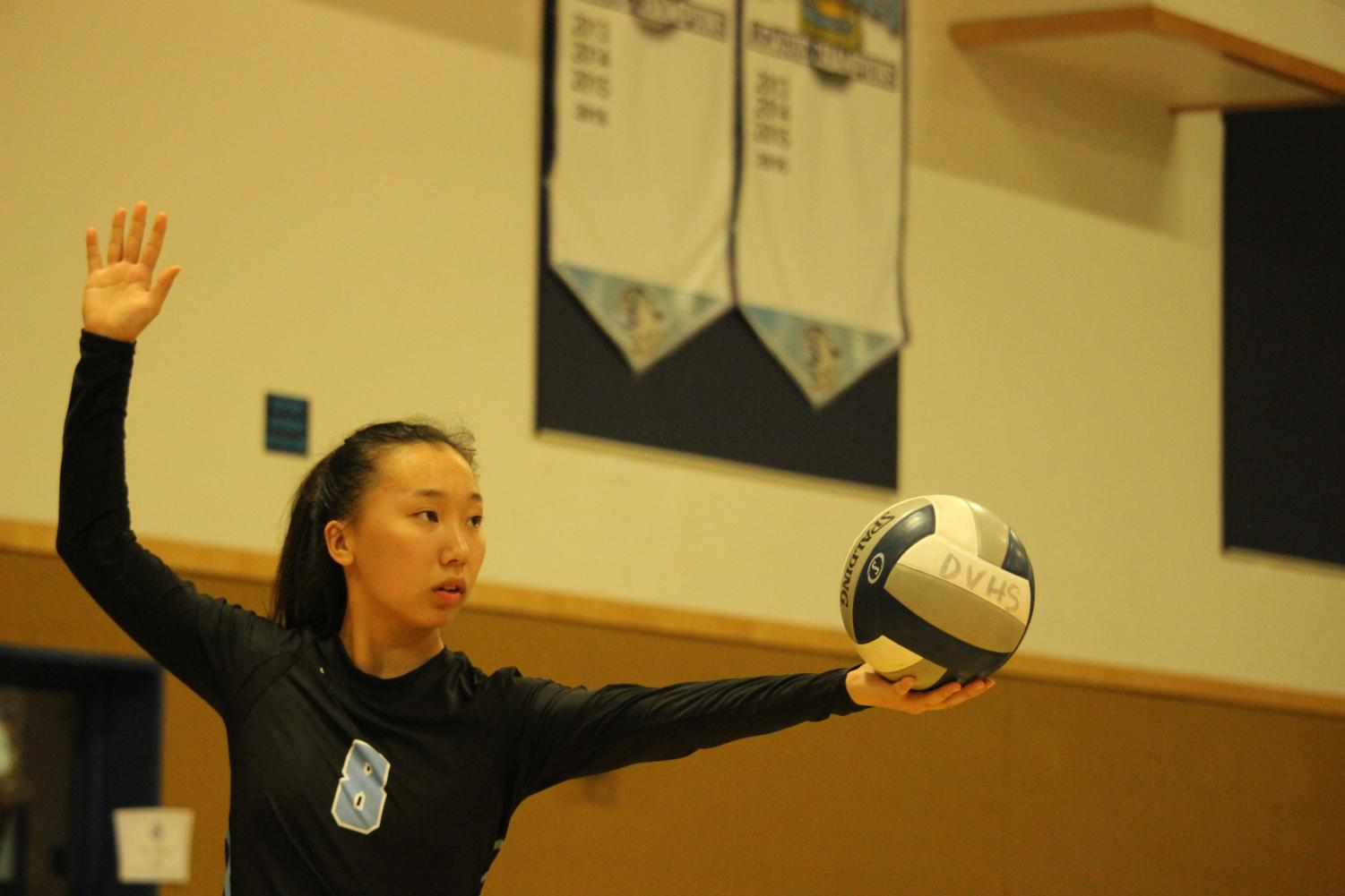 Dougherty Valley junior Elizabeth Lee prepares to serve the ball toward the California High side.