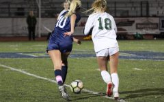 Junior winger Alyssa O'Brien dribbles past San Ramon Valley junior Hannah Sprinkle.