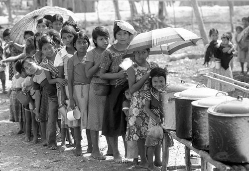 Guatemalan children living in refugee camps, in the State of Campeche, wait to get their food ration.