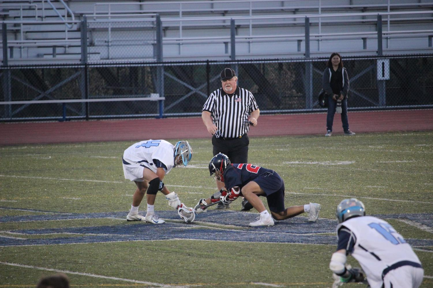 Dougherty Valley senior attacker Hudson Price faced off against a Dublin Gael at a home conference game on April 16.
