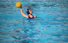 Junior Witney Lam prepares to throw the ball to her teammate