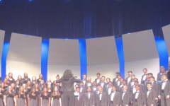 Ms. Walker leads DVHS choir during their fall concert.