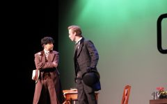AJ Sohrabi, as Algernon Moncrieff, and Jose Saramiento, as John Worthing, argue over the name of Ernest.