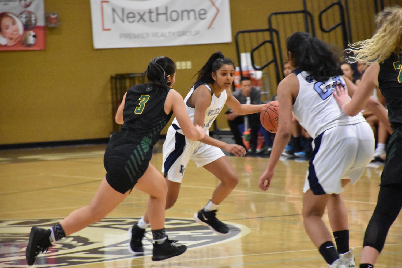Senior Karina Shah prepares to pass the ball to her teammate.