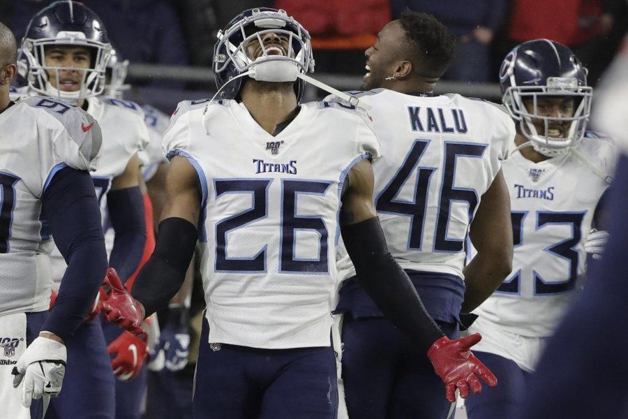 Titans cornerback Logan Ryan intercepts Patriots quarterback Tom Brady's pass for a touchdown.