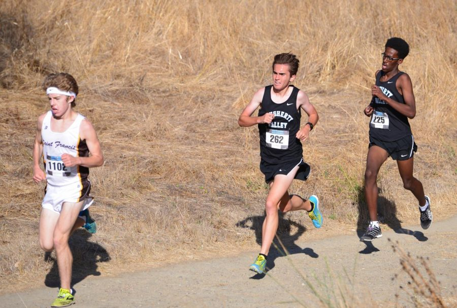 Schneider (center) races at the Scott Bauhs Invitational on Sept. 28, 2019.