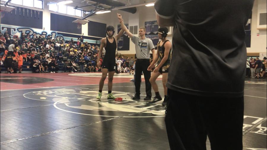 Faizan wins a round in his least favorite sport - wrestling