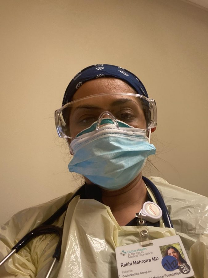 Dr. Rakhi Mehrotra wears her PPE in the Pediatric respiratory/COVID clinic at the hospital
