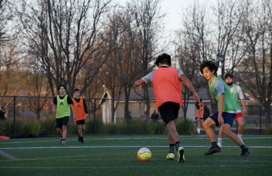 As restrictions on youth sports loosen, players on San Ramon FC practice at Tiffany Roberts Sports Field without masks on.