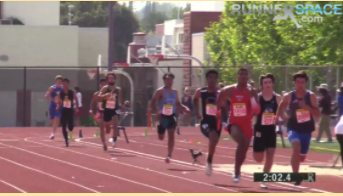 Arcadia Invitational: Aryan Srivastana, 10, the 5th runner from the right in DVs light blue jersey, runs past the 200 meter curve, 200 meters left to go.