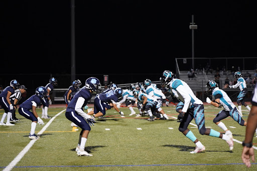 The Wolverine offense attempts to score near the goal line.
