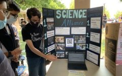 Anirudh Basu, senior and co - president of Science Alliance, introduces his club to potential members during in-person Club Day.