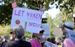 Women gather together in union at downtown Danville to protest against the abortion laws.
